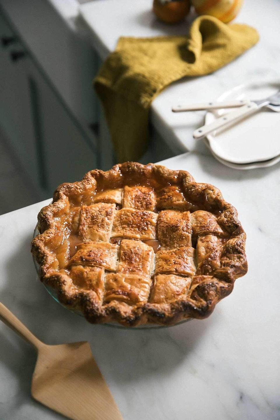 "<p>If you're looking for the perfect traditional apple-pie recipe, you've come to the right place. This mouthwatering recipe is easy, classic, and almost too good to be true. Honey crisp and Braeburn apples are combined with sugar and spices to make this flavorful pie a treat for everyone's taste buds.</p> <p><strong>Get the recipe</strong>: <a href=""https://www.acozykitchen.com/a-classic-apple-pie"" class=""link rapid-noclick-resp"" rel=""nofollow noopener"" target=""_blank"" data-ylk=""slk:classic apple pie"">classic apple pie</a></p>"