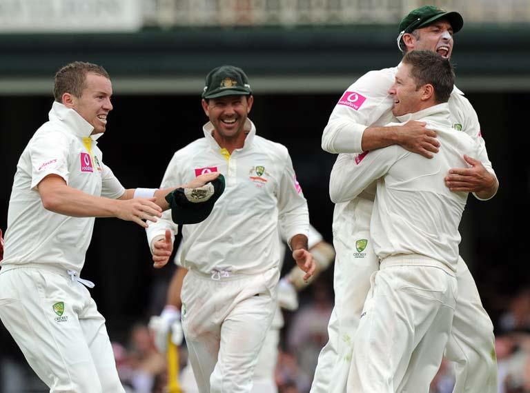 After catching legendary Indian batsmen Sachin Tendulkar for 80 at first slip, Mike Hussey (R) leaps into the arms of Australian captain and bowler Michael Clarke (2nd R) as teammates Peter Siddle (L) and former captain Ricky Ponting (2nd L) join in the celebrations during the second cricket Test against Australia and the 100th Test at the Sydney Cricket Ground (SCG) on January 6, 2012. The prized wicket capped a dream Test for Australian skipper Clarke, who scored an unbeaten 329 in Australia's massive first innings of 659 for four declared.
