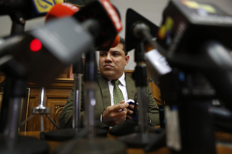 Lawmaker Luis Parra gives a press conference at the National Assembly in Caracas, Venezuela, Monday, Jan. 6, 2020. The previous day, lawmakers loyal to President Nicolas Maduro rushed to choose Parra as their new legislative president, while many opposition lawmakers were blocked from entering the voting session. (AP Photo/Andrea Hernandez Briceño)