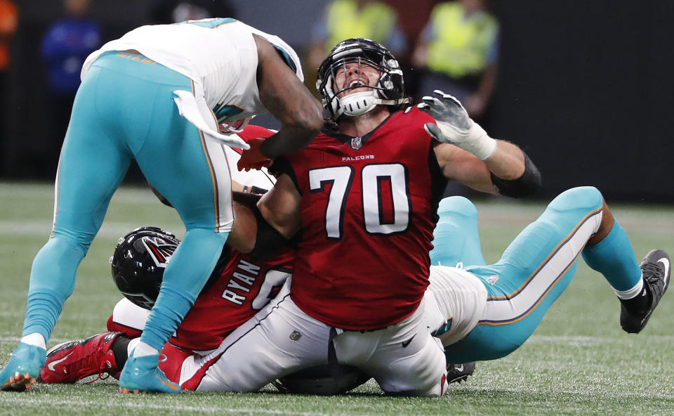 <p>Atlanta Falcons offensive tackle Jake Matthews (70) reacts to players on his legs as Matt Ryan is sacked against the Miami Dolphins during the second half of an NFL football game, Sunday, Oct. 15, 2017, in Atlanta. (AP Photo/David Goldman) </p>