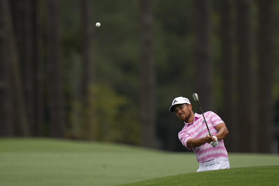 Xander Schauffele hits on the eighth fairway during the third round of the Masters golf tournament on Saturday, April 10, 2021, in Augusta, Ga. (AP Photo/Matt Slocum)
