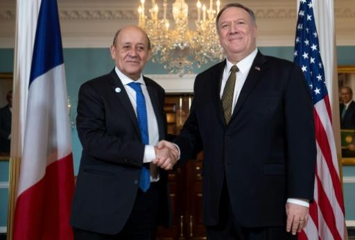 French Foreign Minister Jean-Yves Le Drian (left), seen here shaking hands with US Secretary of State Mike Pompeo in Washington last November, says Europe must 'invent a third way' with regard to China