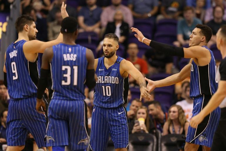 Both of Orlando's leading scorers missed the game against the Pistons with Aaron Gordon (R) sidelined by a calf strain and Evan Fournier (C) sitting out for the fifth consecutive game with a right ankle sprain