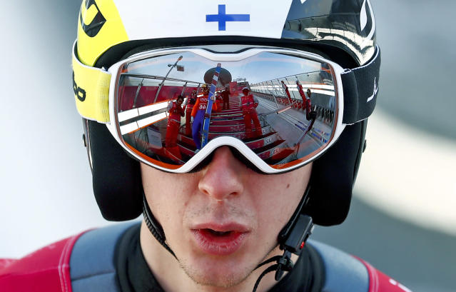 <p>Fellow jumpers are reflected in the goggles of Ilkka Herola, of Finland, during training for the men's nordic combined competition at the 2018 Winter Olympics in Pyeongchang, South Korea, Tuesday, Feb. 13, 2018. (AP Photo/Matthias Schrader) </p>