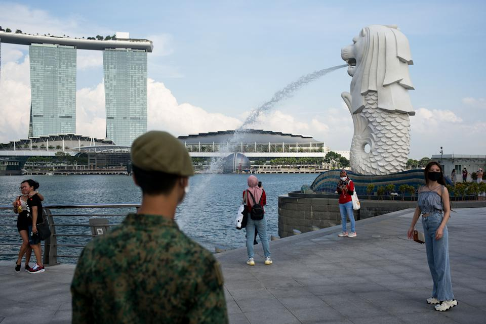 A soldier asks the public to exit the Merlion park due to the closure of the place for the Singapore National Day celebration last year.Singapore celebrated its 55th National Day on the 9th of August 2020 amid the Covid-19 pandemic. (Photo by Maverick Asio/SOPA Images/LightRocket via Getty Images)