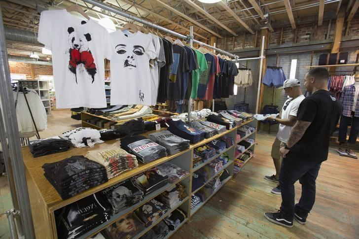 Patrons browse the t-shirt isle at an Urban Outfitters store in Pasadena, California