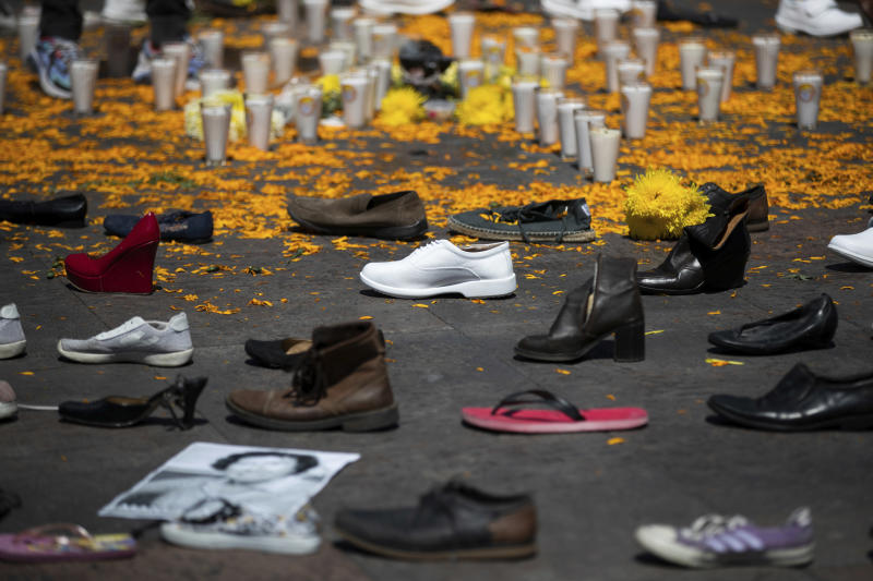 Shoes representing massacred students and civilians cover the Plaza of the Three Cultures during a ceremony commemorating the Tlatelolco student massacre where they were attacked by the military and police, in Mexico City, Friday, Oct. 2, 2020. The annual march to the Zocalo was canceled amid the COVID-19 pandemic. (AP Photo/Fernando Llano)