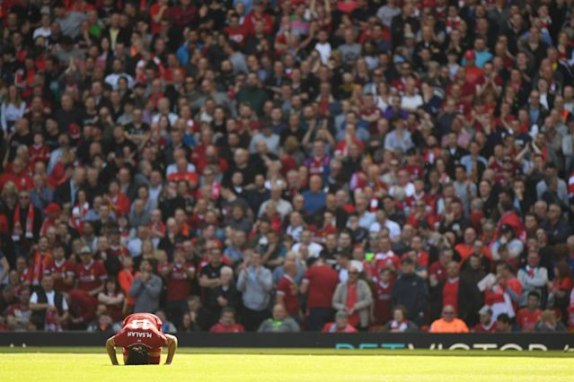 Mohamed Salah kisses the turf after scoring: Getty Images