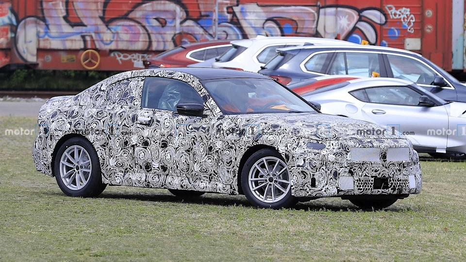 """<p>Here's another look at the upcoming 2 Series Coupe.</p> <h3><a href=""""https://www.motor1.com/news/434309/bmw-2-series-coupe-spied/"""" rel=""""nofollow noopener"""" target=""""_blank"""" data-ylk=""""slk:BMW 2 Series Coupe Spied Hiding Its Updated Design"""" class=""""link rapid-noclick-resp"""">BMW 2 Series Coupe Spied Hiding Its Updated Design</a></h3> <br><a href=""""https://www.motor1.com/news/430129/bmw-2-series-active-tourer-spied/"""" rel=""""nofollow noopener"""" target=""""_blank"""" data-ylk=""""slk:Next-Gen BMW 2 Series Active Tourer Fleet Spied In The Alps"""" class=""""link rapid-noclick-resp"""">Next-Gen BMW 2 Series Active Tourer Fleet Spied In The Alps</a><br><a href=""""https://www.motor1.com/news/423199/bmw-2-series-active-tourer-spied/"""" rel=""""nofollow noopener"""" target=""""_blank"""" data-ylk=""""slk:New BMW 2 Series Active Tourer Spied On The 'Ring Looking Agile"""" class=""""link rapid-noclick-resp"""">New BMW 2 Series Active Tourer Spied On The 'Ring Looking Agile</a><br>"""