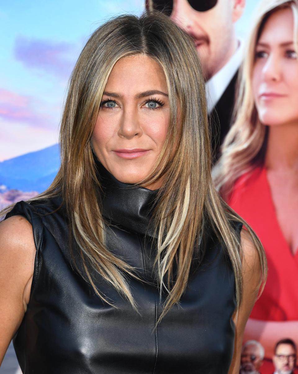 Jennifer Aniston shows off her gorgeous complexion at the LA Premiere of Netflix's Murder Mystery [Photo: Getty Images]