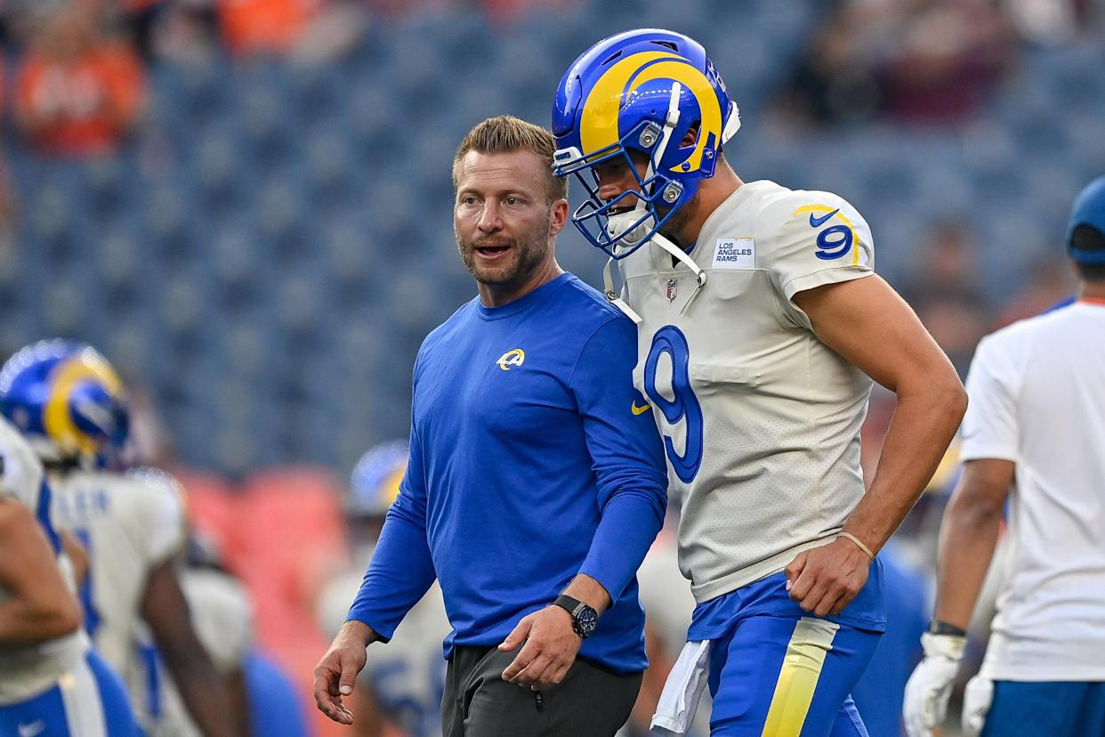 DENVER, COLORADO - AUGUST 28:  Matthew Stafford #9 of the Los Angeles Rams walks off the field with head coach Sean McVay as players warm up before a game against the Denver Broncos at Empower Field at Mile High on August 28, 2021 in Denver, Colorado. (Photo by Dustin Bradford/Getty Images)