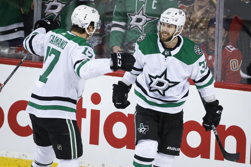 Dallas Stars' Justin Dowling celebrates his goal with teammate Nick Caamano during the third period of an NHL hockey game against the Calgary Flames on Wednesday, Nov. 13, 2019, in Calgary, Alberta. (Jeff McIntosh/The Canadian Press via AP)