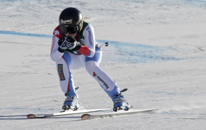 Switzerland's Lara Gut heads for the finish line during the women's World Cup Downhill skiing competition, Friday, Nov. 29, 2013, in Beaver Creek, Colo. (AP Photo/Charles Krupa)