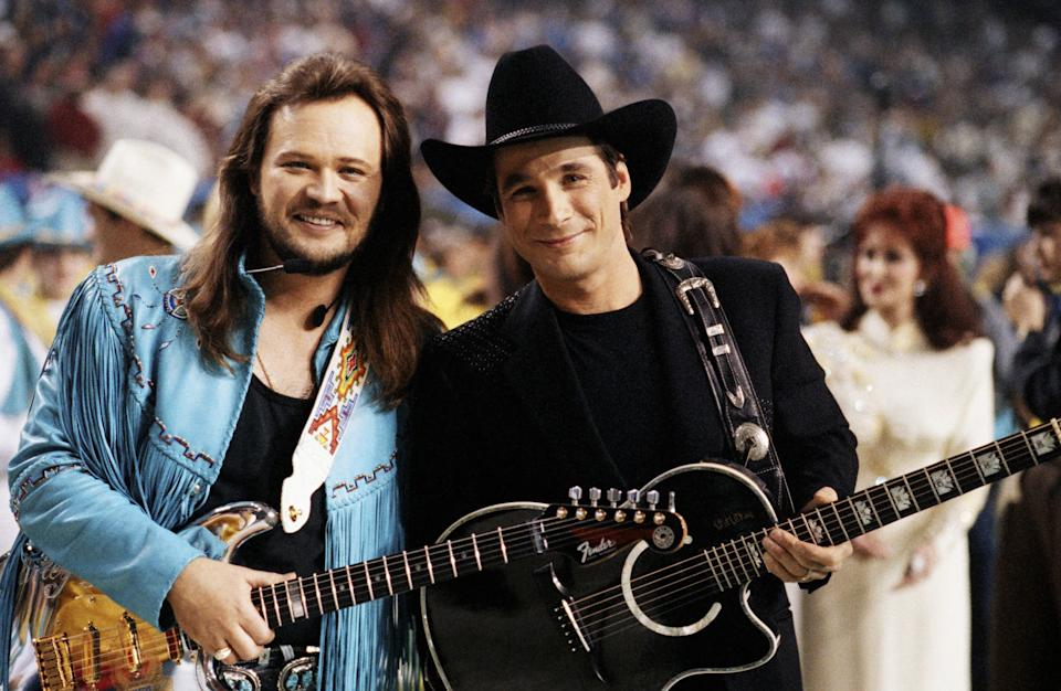 Country singer Travis Tritt (left) and Clint Black pose together before the half-time show at the 1994 Atlanta, Georgia, Superbowl XXVII football game held at the Georgia Dome. (Photo by George Rose/Getty Images)