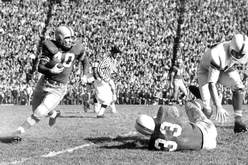 """FILE - In this Nov. 1955, file photo, Ohio State halfback Howard """"Hopalong"""" Cassady (40) carries the ball against Indiana during a college football game in Columbus, Ohio. Cassady, a Heisman Trophy winner and former NFL running back, died early Friday, Sept. 20, 2019, in Tampa, Fla.,  Jerry Emig, the Ohio State associate athletic director said. He was 85. Cassady played both football and baseball at Ohio State in the early 1950s, winning the Heisman Trophy in 1955. He also played 10 seasons in the NFL, mostly with the Detroit, and got the nickname """"Hopalong"""" from local sports writers after the black-hatted Western star of the 1950s.  (AP photo)"""