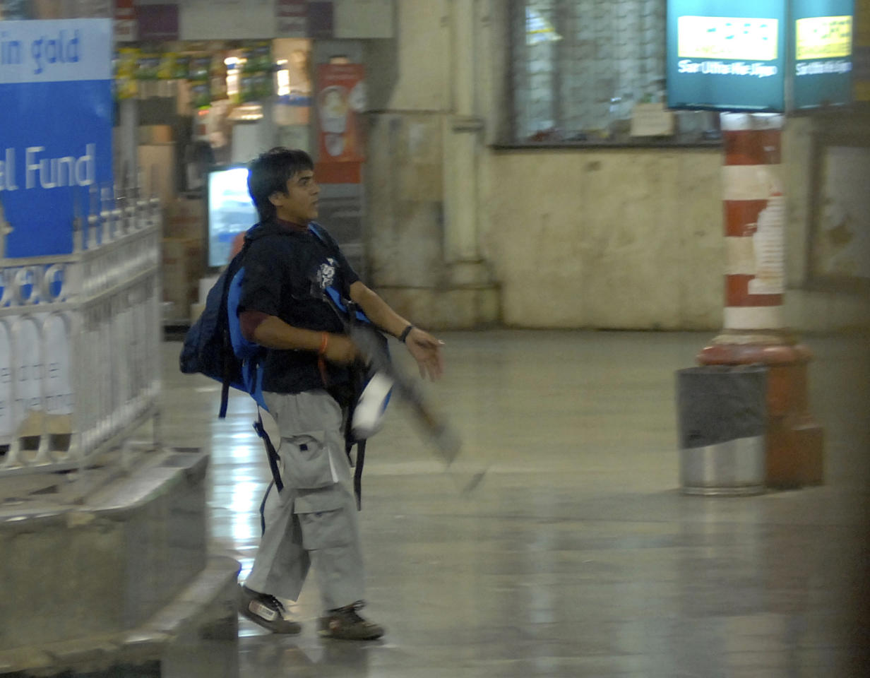 FILE - In this Nov. 26, 2008 file photo, Ajmal Kasab, one of the accused gunmen, walks at the Chatrapathi Sivaji Terminal railway station in Mumbai, India. India executed the lone surviving gunman from the 2008 terror attack on Mumbai early Wednesday, Nov. 21, 2012, India's home ministry said. Kasab, a Pakistani citizen, was one of 10 gunmen who rampaged through the streets of India's financial capital in November 2008, killing 166 people. Kasab was hung at a jail in Pune, a city near Mumbai, after India's president rejected his plea for mercy.(AP Photo/Mumbai Mirror, Sebastian D'souza, File) FULL CREDIT MANDATORY, INDIA OUT