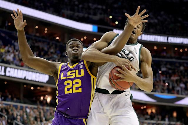 <p>Xavier Tillman #23 of the Michigan State Spartans rebounds against Darius Days #22 of the LSU Tigers during the first half in the East Regional game of the 2019 NCAA Men's Basketball Tournament at Capital One Arena on March 29, 2019 in Washington, DC. (Photo by Patrick Smith/Getty Images) </p>