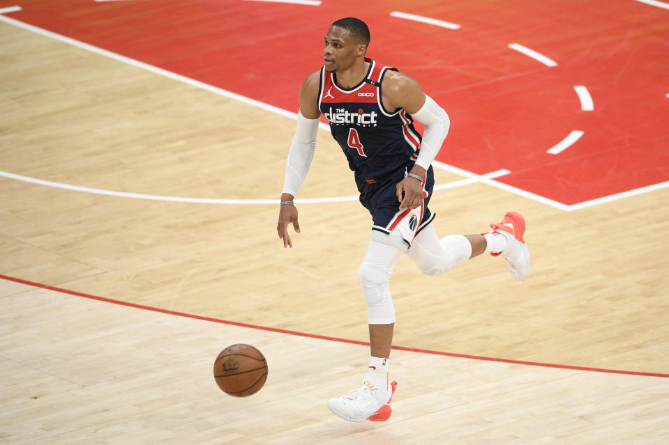 Washington Wizards guard Russell Westbrook (4) dribbles the ball during the first half of an NBA basketball game against the Cleveland Cavaliers, Friday, May 14, 2021, in Washington. (AP Photo/Nick Wass)