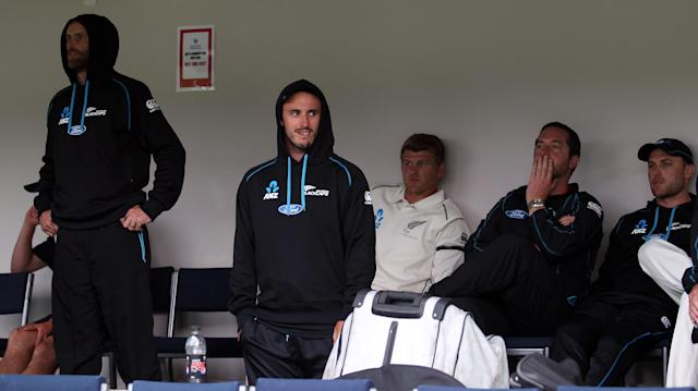 DUNEDIN, NEW ZEALAND - DECEMBER 07: Dejected New Zealand players Aaron Redmond, Hamish Rutherford, Corey Anderson and Brendon McCullum look on as rain continues, forcing a draw after day five of the first test match between New Zealand and the West Indies at University Oval on December 7, 2013 in Dunedin, New Zealand. (Photo by Rob Jefferies/Getty Images)
