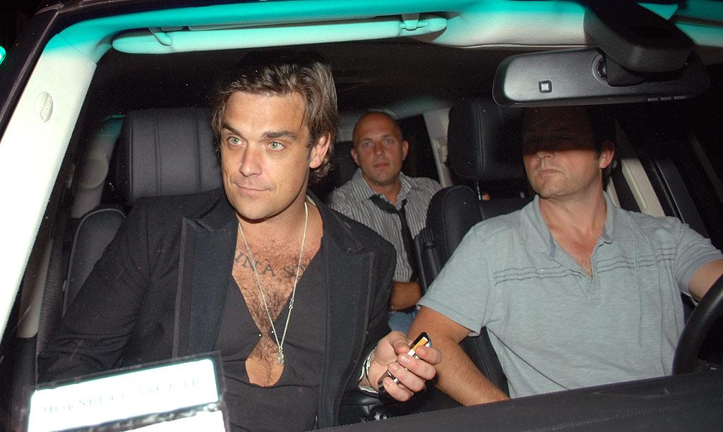 "The hirsute Robbie Williams is undoubtedly sexy, but his safety-pinned shirt reveals a few too many fuzzies. King Paparazzi/<a href=""http://www.splashnewsonline.com"" target=""new"">Splash News</a> - June 17, 2008"