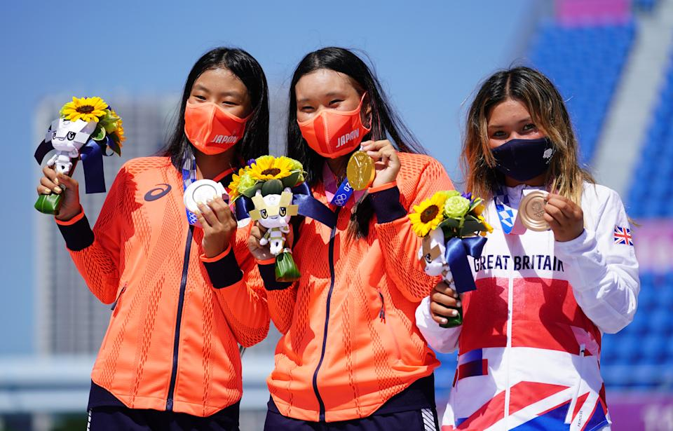 Great Britain's Sky Brown (right) celebrates winning the bronze medal, alongside Japan's Sakura Yosozumi who won gold and Japan's Sakura Kokona Hiraki (left) who won silver during the Women's Park Final at Ariake Sports Park on the twelfth day of the Tokyo 2020 Olympic Games in Japan. Picture date: Wednesday August 4, 2021. (Photo by Adam Davy/PA Images via Getty Images)