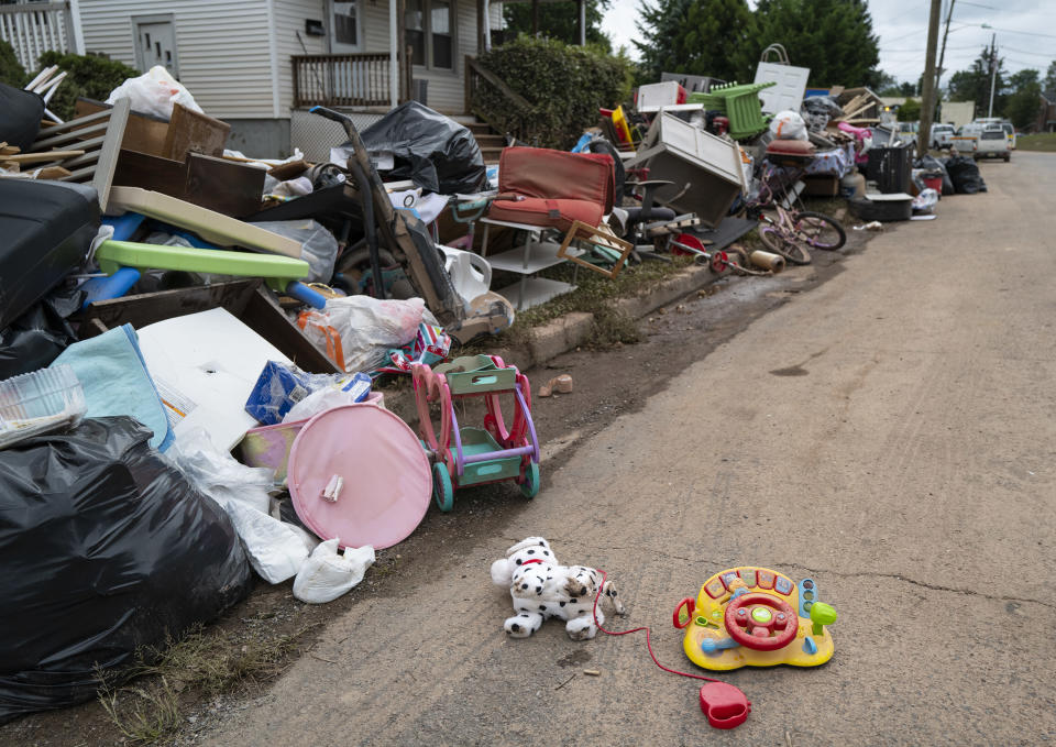 Debris from flood damage caused by the remnants of Hurricane Ida lie on the side of a street in Manville, N.J., Sunday, Sept. 5, 2021. Flood-stricken families and business owners across the Northeast are hauling waterlogged belongings to the curb and scraping away noxious mud as cleanup from Ida moves into high gear. (AP Photo/Craig Ruttle)