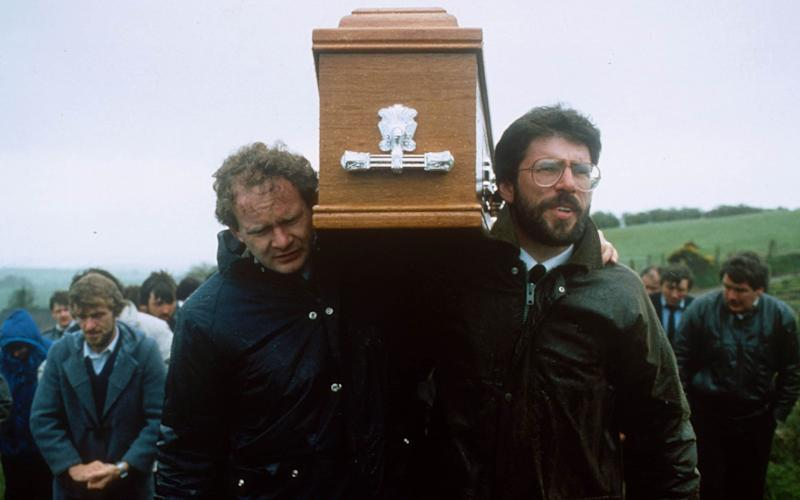 Martin McGuinness and Getty Adams carry a small victim of the IRA to his grave in May 1987 - Credit: Eyevine