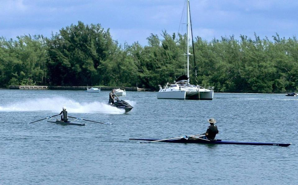 Rowers Sue and Ron Kern, like other rowers and paddlers in the Miami Marine Stadium basin, worry about getting swamped or plowed over by water bikers. A huge increase in water bike and powerboat traffic has created a chaotic and dangerous situation at the lagoon.