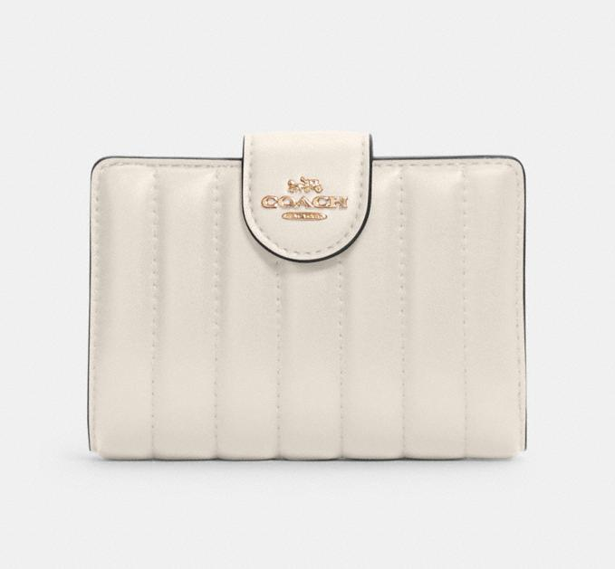Medium Corner Zip Wallet With Quilting. Image via Coach Outlet.