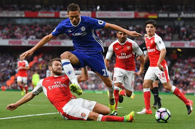 Arsenal's defender Shkodran Mustafi (L) slides in to tackle Chelsea's midfielder Nemanja Matic (2L) at the Emirates Stadium in London on September 24, 2016 (AFP Photo/Ben Stansall)