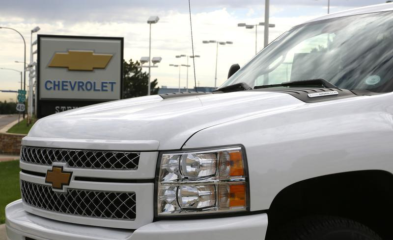 The sign at a General Motors Chevrolet dealer is seen behind a Chevrolet pickup truck in Golden