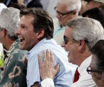 Dr. Kendall Hansen (left) reacts in 2012 at the Kentucky Derby after his horse with owner James Shircliff (right) is placed in the No. 14 post position.