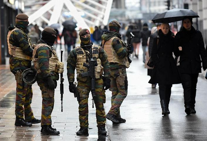 The city's historic Grand Place, usually bustling with tourists, has been quiet over the weekend as Brussels enters a third day of lockdown (AFP Photo/John Thys)
