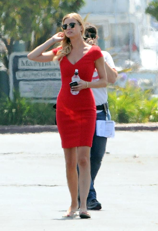 "Emily VanCamp, who plays Emily Thorne on ABC's hit drama ""Revenge,"" was spotted on the show's set in Marina Del Rey, California flaunting her svelte figure in a red sheath dress -- definitely a frock we'd find in her character's closet. The 26-year-old actress wore her blonde locks in loose curls swept to one side and sported a pair of wayfarer shades. VanCamp looked chic and elegant.<br><br>Season 2 of ""Revenge"" premieres on September 30 at a new timeslot -- moving from Wednesdays to Sundays at 9 PM on ABC."