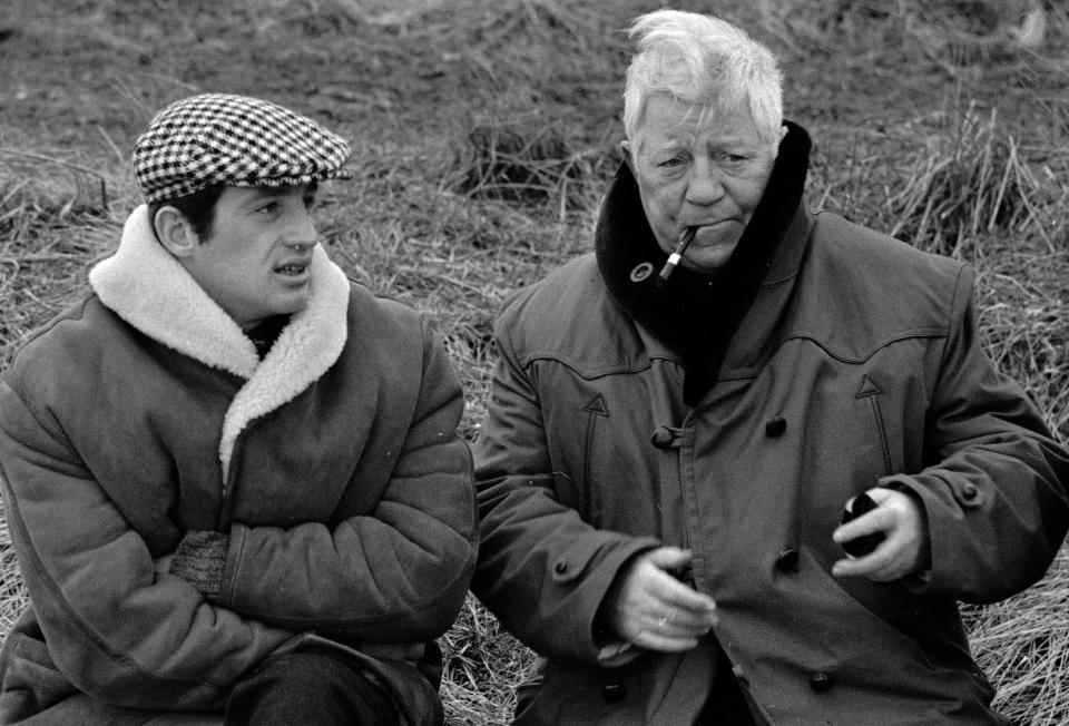 """FILE - In this Jan. 26, 1962 file photo, French actors Jean Gabin, right, and Jean-Paul Belmondo are shown in a scene from the film """"A Monkey In Winter,"""" in Normandy. French New Wave actor Jean-Paul Belmondo has died, according to his lawyer's office on Monday Sept. 6, 2021. (AP Photo/File)"""