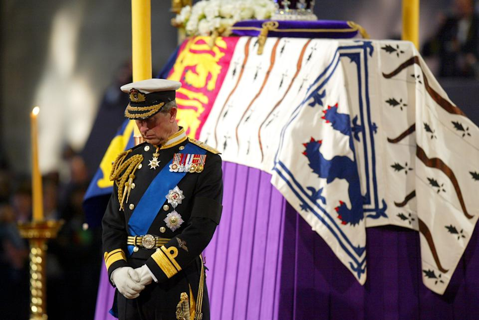 LONDON, UNITED KINGDOM:  Prince Charles stands vigil beside the Queen Mother's coffin while it lies-in-state at Westminster Hall in London 08 April 2002. The funeral ceremony will be held at Westminster Abbey 09 April. AFP PHOTO Adrian DENNIS WPA POOL (Photo credit should read ADRIAN DENNIS/AFP via Getty Images)
