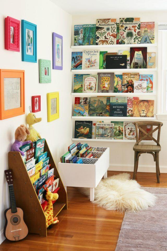 """<p>Create a reading corner for your kiddos by decking out a space with open shelving, a display case, and a book bin for all their favorite stories.</p><p><strong>See more at </strong><strong><a href=""""https://www.helenmilan.com/diy-book-bin/"""" rel=""""nofollow noopener"""" target=""""_blank"""" data-ylk=""""slk:Helen Milan"""" class=""""link rapid-noclick-resp"""">Helen Milan</a>.</strong></p><p><strong><a class=""""link rapid-noclick-resp"""" href=""""https://www.amazon.com/s?k=bookshelves+kids&ref=nb_sb_noss_2&tag=syn-yahoo-20&ascsubtag=%5Bartid%7C10063.g.36014277%5Bsrc%7Cyahoo-us"""" rel=""""nofollow noopener"""" target=""""_blank"""" data-ylk=""""slk:SHOP KIDS' BOOKSHELVES"""">SHOP KIDS' BOOKSHELVES</a><br></strong></p>"""