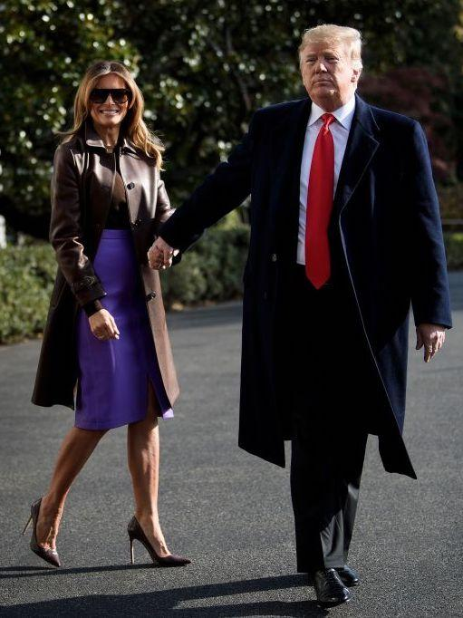 <p>On November 29, Melania Trump headed to Marine One on the South Lawn of the White House in a £4,600 Ralph Lauren coat. She finished the look with Manolo Blahnik heels and a lilac skirt by New York-based designer, Derek Lam. <em>[Photo: Getty]</em> </p>