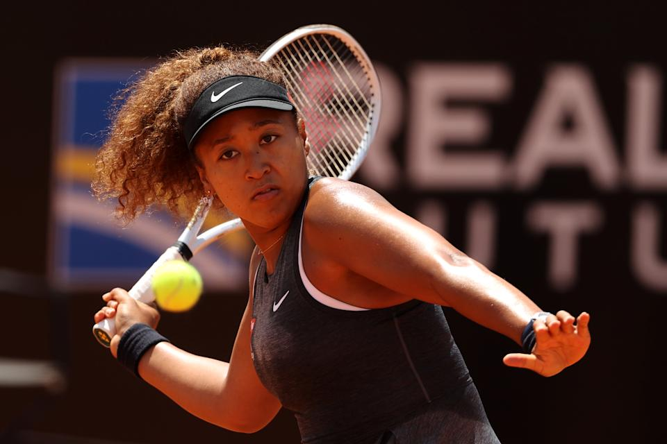 ROME, ITALY - MAY 12:  Naomi Osaka of Japan returns a forehand on day 5 of the the Internazionali BNL d'Italia match between Naomi Osaka of Japan and Jessica Pegula of USA at Foro Italico on May 12, 2021 in Rome, Italy. Sporting stadiums around Italy remain under strict restrictions due to the Coronavirus Pandemic as Government social distancing laws prohibit fans inside venues resulting in games being played behind closed doors. (Photo by Clive Brunskill/Getty Images)