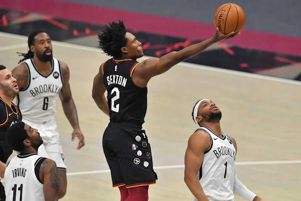 CLEVELAND, OHIO - JANUARY 22: Collin Sexton #2 of the Cleveland Cavaliers shoots over Bruce Brown #1 of the Brooklyn Nets during the first quarter at Rocket Mortgage Fieldhouse on January 22, 2021 in Cleveland, Ohio. NOTE TO USER: User expressly acknowledges and agrees that, by downloading and/or using this photograph, user is consenting to the terms and conditions of the Getty Images License Agreement. (Photo by Jason Miller/Getty Images)