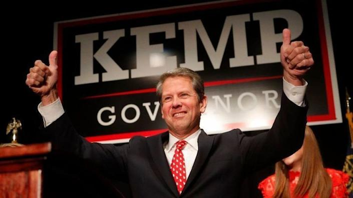 """Brian Kemp, then a Republican gubernatorial candidate in Georgia, attends a rally in Athens in 2018. <span class=""""copyright"""">(John Bazemore / Associated Press)</span>"""