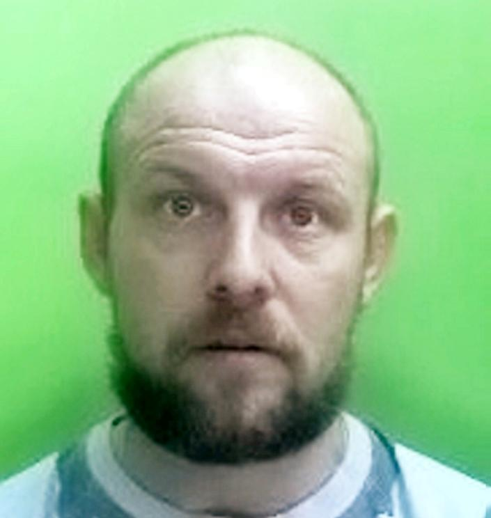Steven Partington was caught on CCTV opening his victim's back door and jumping inside as his vehicle pulled away at the traffic lights (swns)