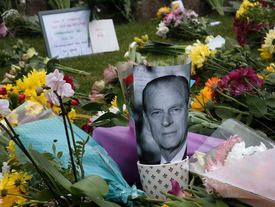 <p>Hundreds of people visited Windsor to mark Prince Philip's death today</p> (AP)