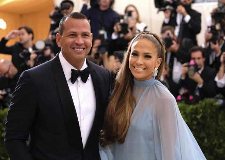 Alex Rodriguez, pictured with girlfriend Jennifer Lopez, is not ready to enter the picture as a potential owner in MLB. (AP)