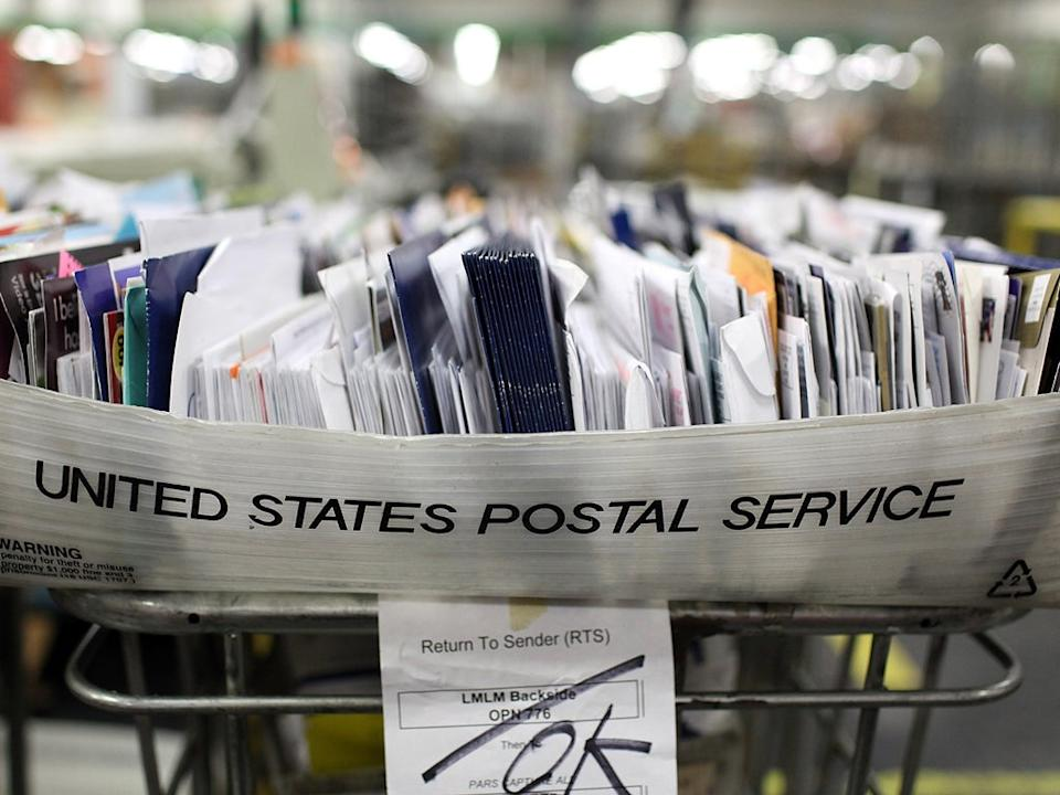 The decline in letter writing and a rise in online bill payments have produced a 20 per cent fall in business for the US mail: Getty Images