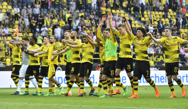 Dortmund's team celebrates after the German Bundesliga soccer match between Borussia Dortmund and VfB Stuttgart in Dortmund, Germany, Sunday, April 8, 2018. (AP Photo/Martin Meissner)