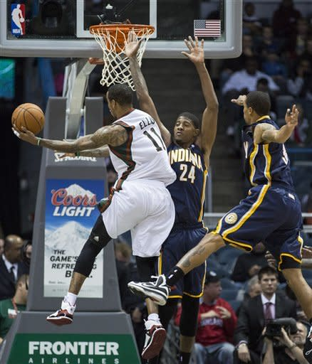 Indiana Pacers' Paul George cannot (24) contain Milwaukee Bucks' Monta Ellis, left, who drove the lane during the second half of an NBA basketball game on Wednesday, Nov. 14, 2012, in Milwaukee. (AP Photo/Tom Lynn)