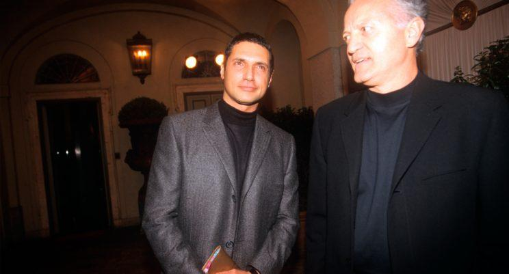 From the left, the fashion designer Antonio D'Amico and Santo Versace, respectively the former partner and the elder brother of the deceased Gianni Versace, are waiting the beginning of the fashion show dedicated to the spring/summer collection at the via Gesù seat. Milan (Italy), 6th March 1998. (Photo: Getty Images)