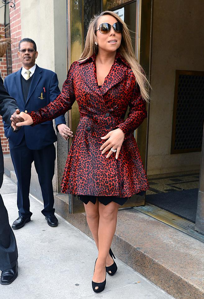 "omg! users were dying to get a glimpse of Mariah Carey rocking a leg-baring trench on Friday, when they voted on <a href=""http://twitter.com/yahooomg"" target=""_blank"">Twitter</a> to add the ""American Idol"" judge to the latest Top Shots update. Mariah wore the coat as she made her way to ABC Studios in New York for an appearance on ""Live! With Michael and Kelly."" Looking good, Mimi! (3/1/2013)"