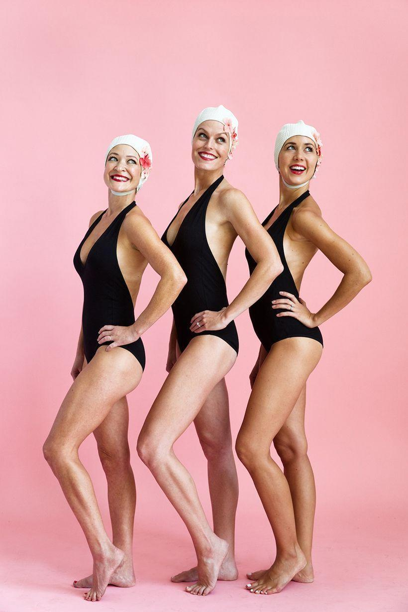 """<p>Show off just how """"in sync"""" you three are with a synchronized swimming costume. Retro-style swim caps lend a wonderfully vintage vibe to this already fabulous look.</p><p><strong>Get the tutorial at <a href=""""https://camillestyles.com/design/synchronized-swimmer-costume/"""" rel=""""nofollow noopener"""" target=""""_blank"""" data-ylk=""""slk:Camille Styles"""" class=""""link rapid-noclick-resp"""">Camille Styles</a>.</strong></p><p><a class=""""link rapid-noclick-resp"""" href=""""https://go.redirectingat.com?id=74968X1596630&url=https%3A%2F%2Fwww.walmart.com%2Fsearch%2F%3Fquery%3Dvintage%2Bswim%2Bcaps&sref=https%3A%2F%2Fwww.thepioneerwoman.com%2Fhome-lifestyle%2Fcrafts-diy%2Fg37066817%2Fhalloween-costumes-for-3-people%2F"""" rel=""""nofollow noopener"""" target=""""_blank"""" data-ylk=""""slk:SHOP VINTAGE SWIM CAPS""""><strong>SHOP VINTAGE SWIM CAPS</strong></a></p>"""